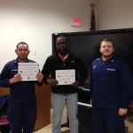 Auxiliarists Spectorman, Richardson, and Toms receiving awards.